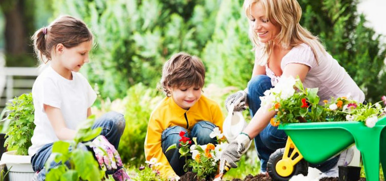 women with two kids gardening