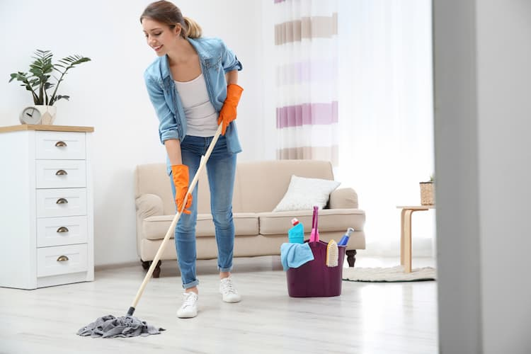 woman cleaning vinyl floor