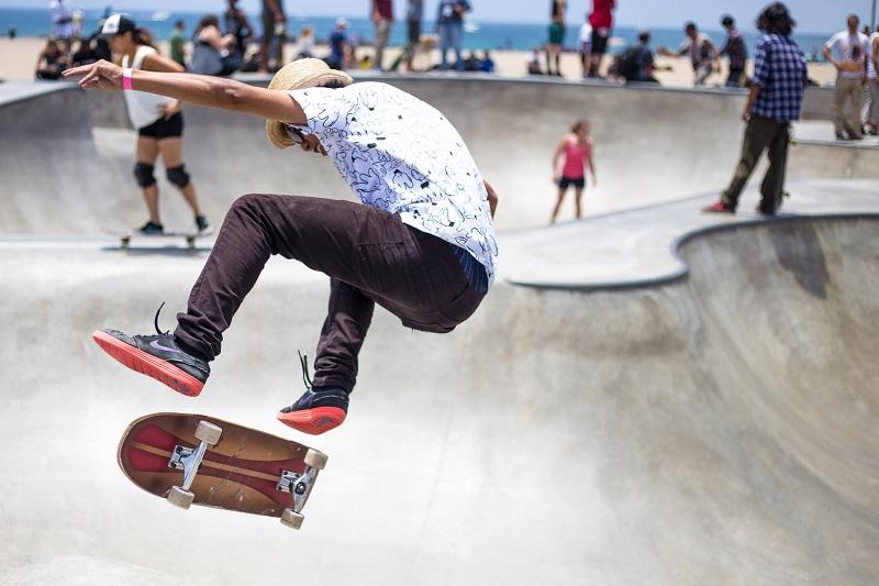 people skateboarding in skateboard park