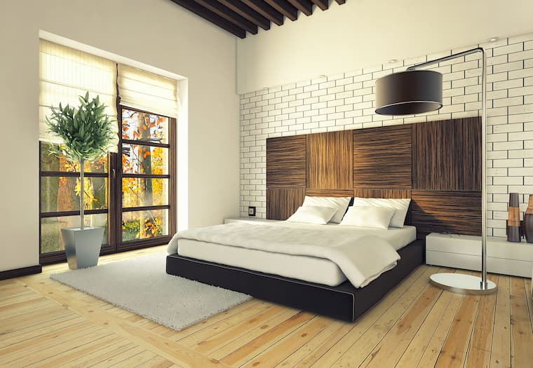 bedroom with wood details and large brown lamp