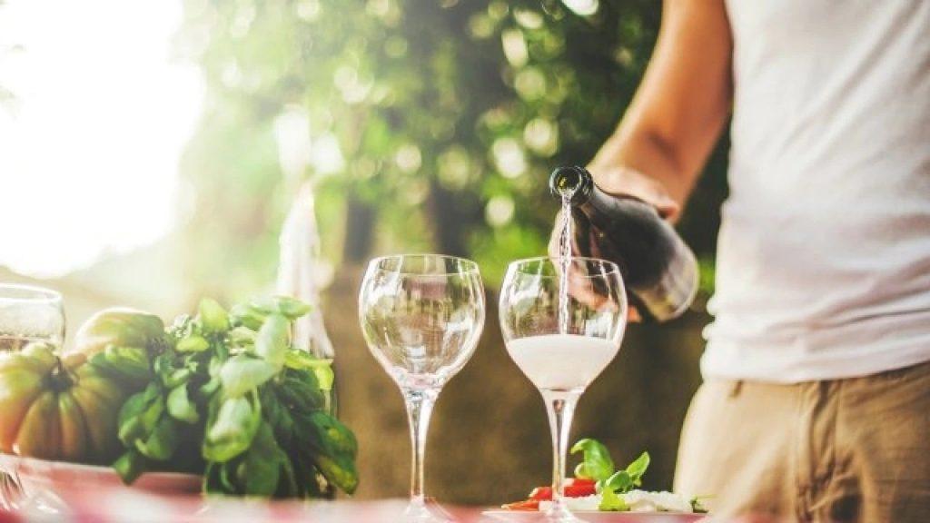 man drinking white wine