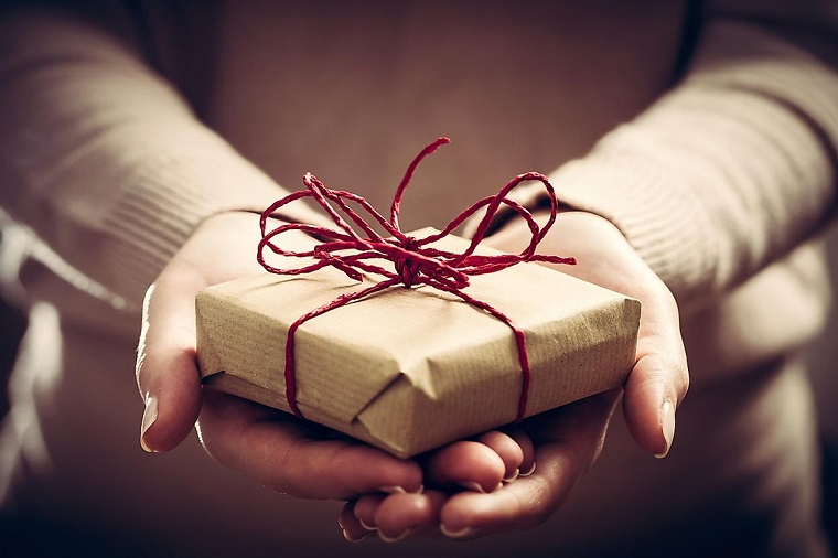 holding gift in hands