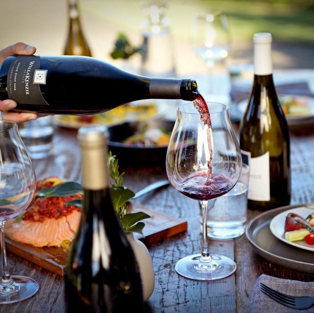 serving pinot noir wine celebrating