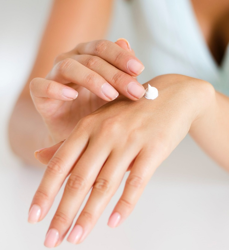 picture of person applying cream on hands