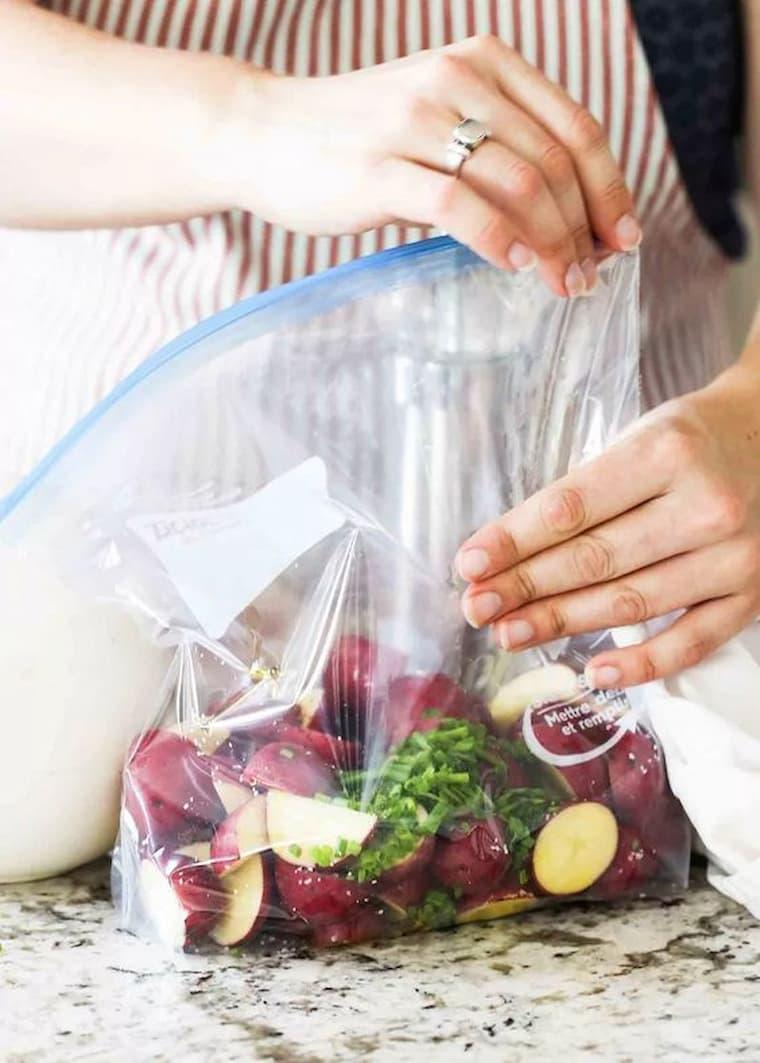 woman sealing food in a vacuum sealer