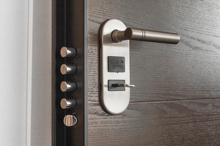 door lock with key on wooden door