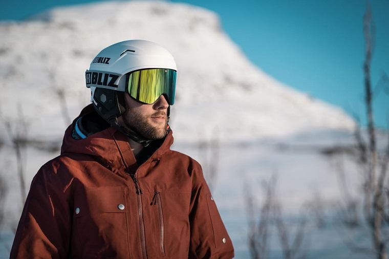 Man with a snowboard helmet