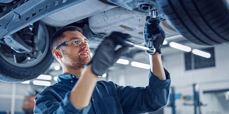 mechanic doing work on vehicle