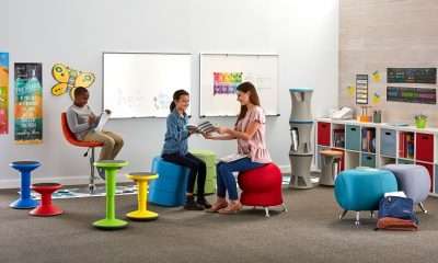 teacher discussing with student in classroom